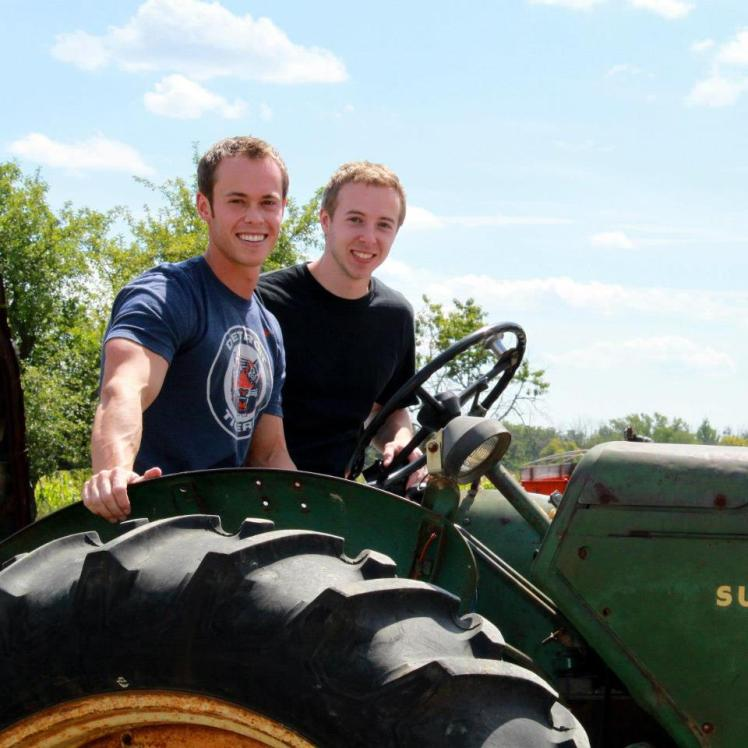 Awesome tractor picture of my brother and I to break up article seriousness. And because I love tractors.